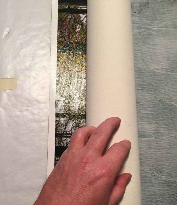 1.  Roll up the print and align the edges