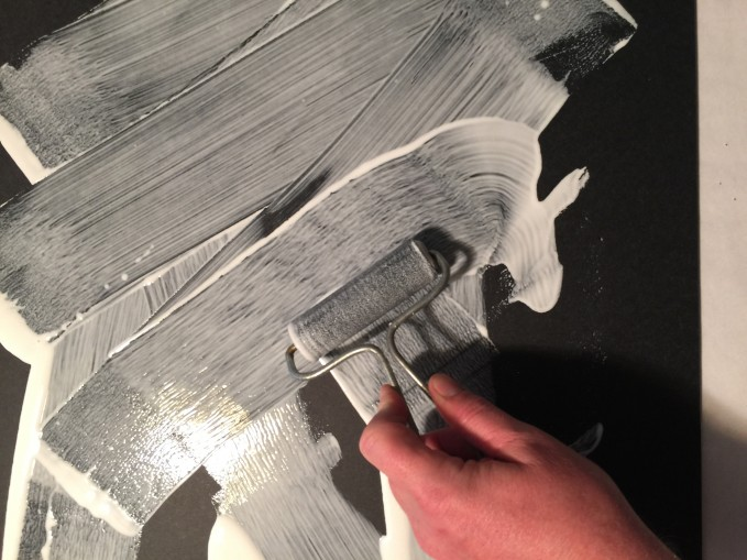 Spreading the glue with a soft burnishing brush